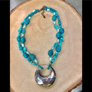 Turquoise stone necklace with silver pendant